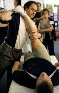 Jonathan Maister demonstrating at Sport Massage Conference
